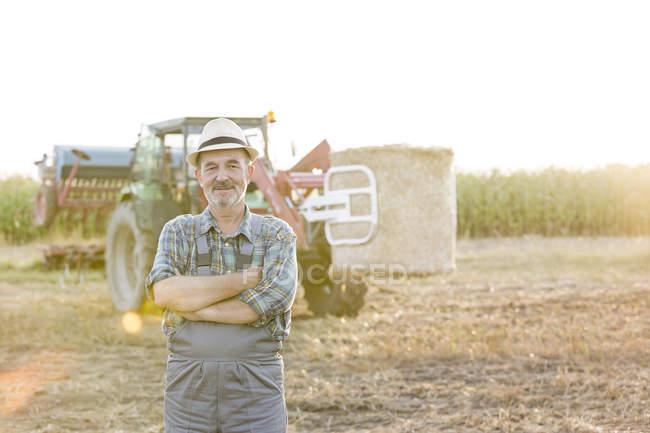 Confident farmer standing on field — Stock Photo