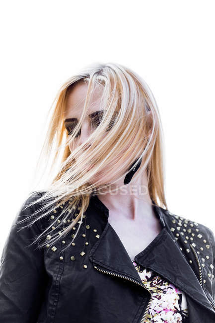 Portrait of blond woman with hair in her face — Stock Photo