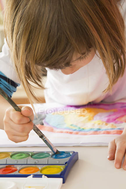 Little girl painting with watercolours — Stock Photo