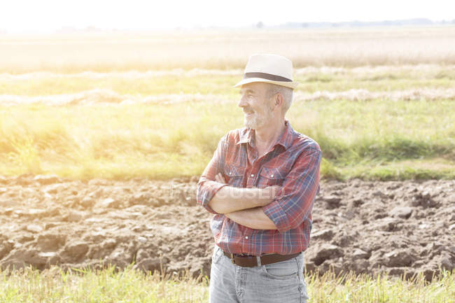Confident farmer standing on field — Stock Photo