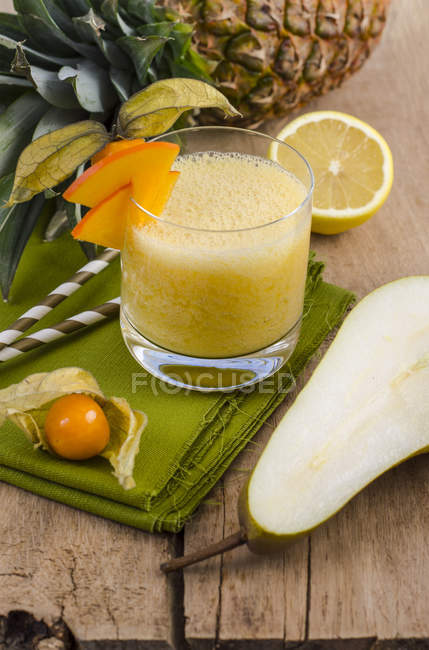 Glass of ananas pear physalis smoothie — Stock Photo