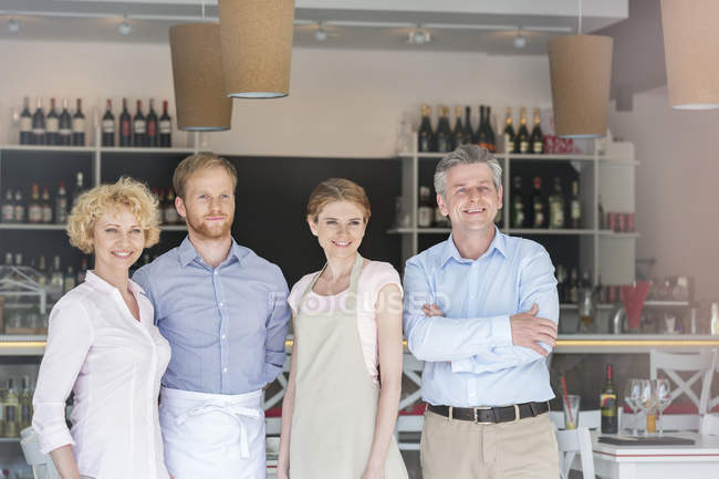 Smiling team in a restaurant by the bar counter — Stock Photo