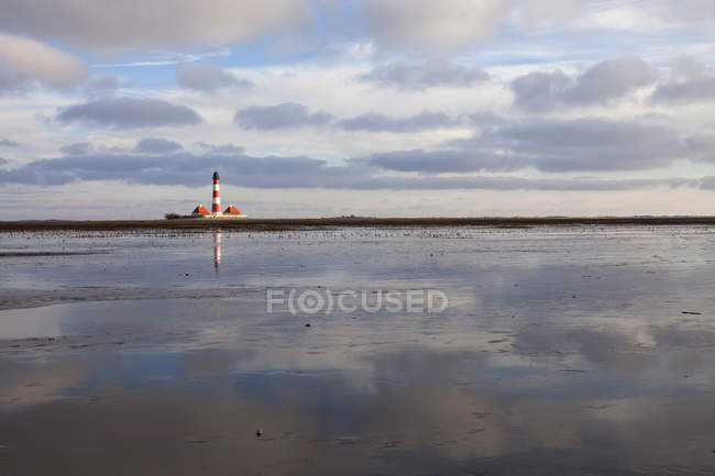 Germany, Schleswig-Holstein, North Sea Coast, View of Westerheversand Lighthouse, Wattenmeer — Stock Photo