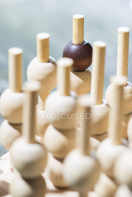 Wooden figures on blurred background — Stock Photo