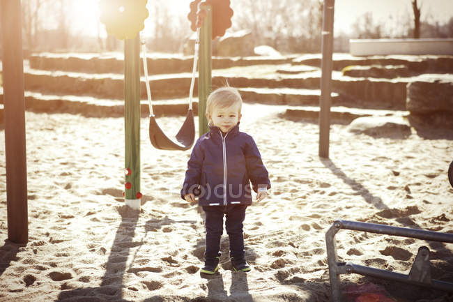 Small toddler standing on playground — Stock Photo