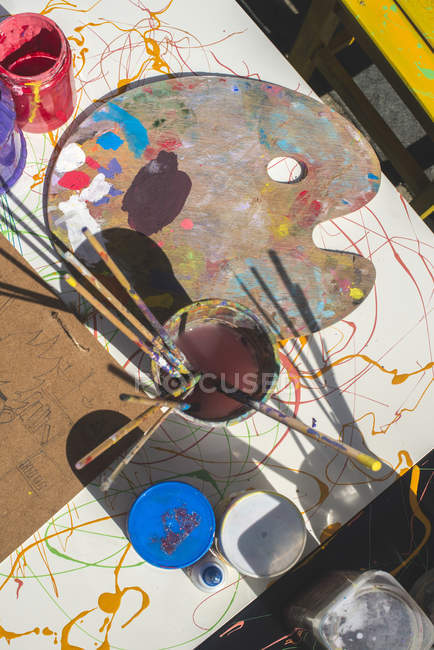 Paints and childish painting equipment — Stock Photo