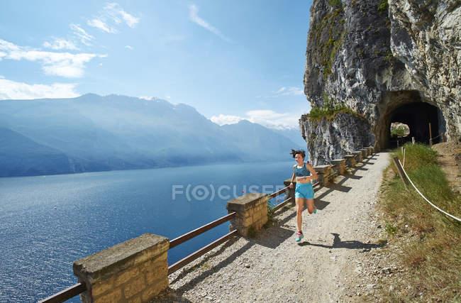 Woman running at Lake Garda — Stock Photo