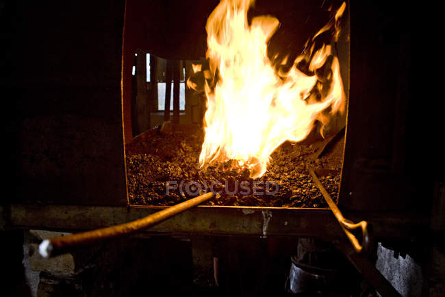 Closeup view of blacksmith fire in fireplace — Stock Photo