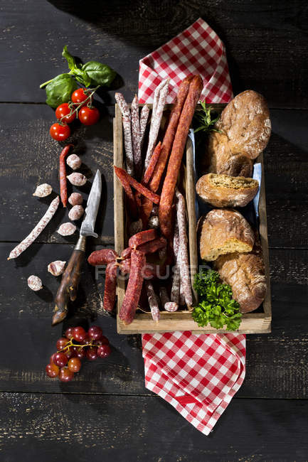 Snack, different types of salami, Pfefferbeisser, Cabanossi and bread — Stock Photo