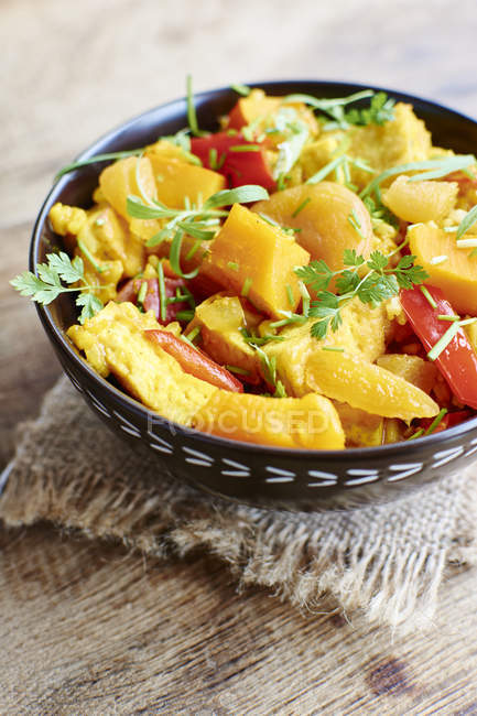 Pumpkin risotto with tofu, apricots, bell pepper and herbs — Stock Photo