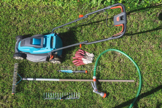 Daytime Top View Of Gardening Tools On Green Grass Color Image