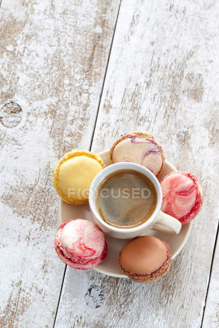 Cup of coffee with five macarons on saucer — Stock Photo