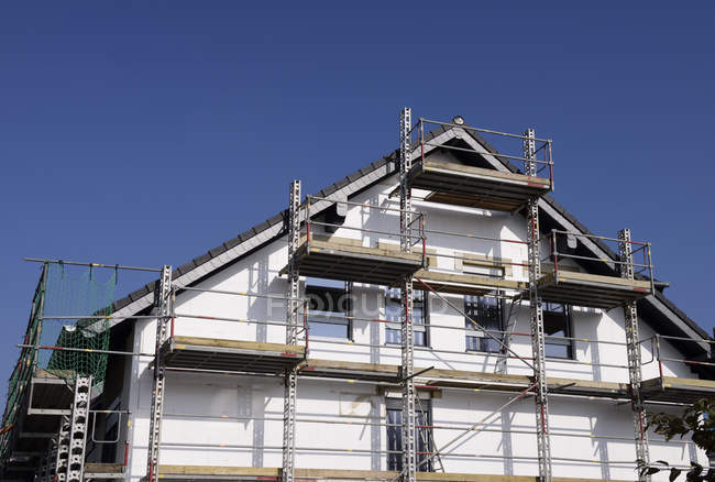 One-family house under construction against sky — Stock Photo