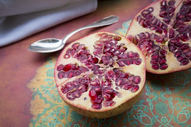 Halves of fresh pomegranate — Stock Photo