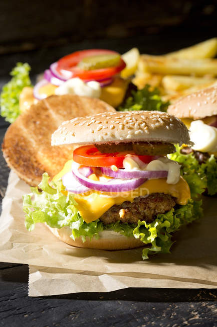 Homemade cheeseburgers with french fries — Stock Photo