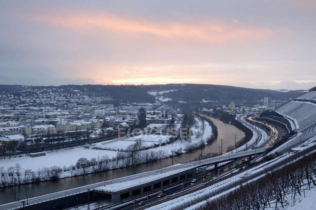 Germany, Wuerzburg, vineyard and traffic at River Main in winter — Stock Photo
