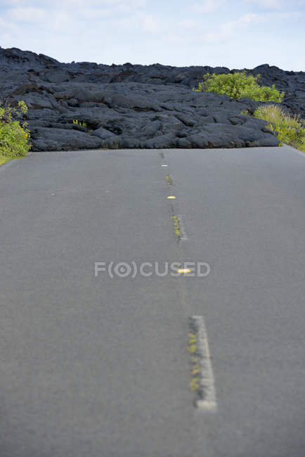 USA, Hawaii, Big Island, Volcanoes National Park, congealed lava on the lane of old Chain of Craters Road — Stock Photo