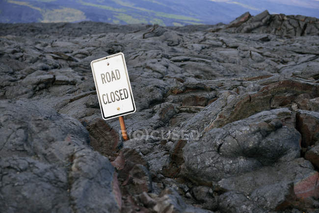 USA, Hawaii, Big Island, Volcanoes National Park, sign lost in lava field — Stock Photo