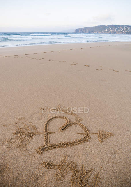 Spain, Valdovino, heart painted in the sand of Frouxeira beach  during daytime — Stock Photo