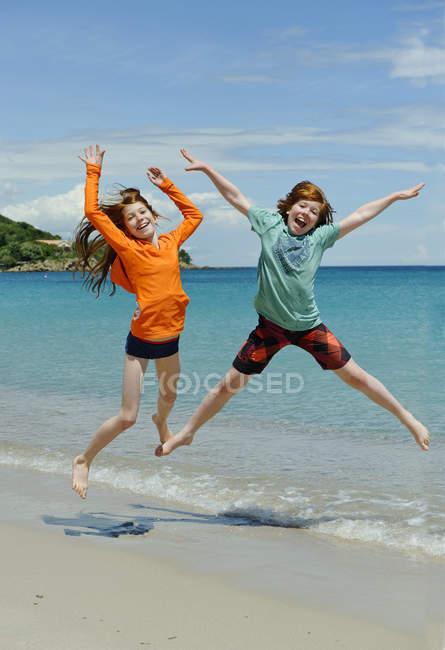 France, Corsica, Favone, children having fun at a beach — Stock Photo