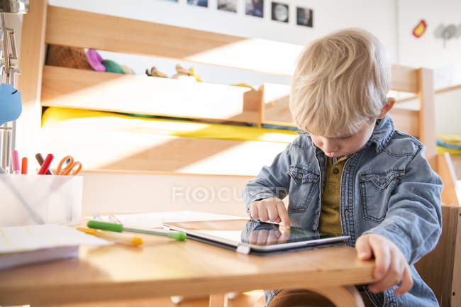 Little boy drawing with digital tablet — Stock Photo