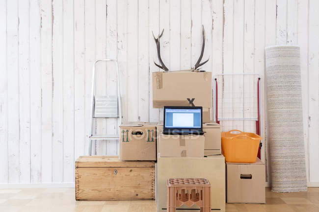 Makeshift home office with laptop on cardboard boxes — Stock Photo