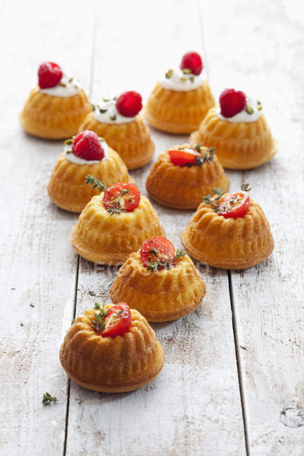 Mini Gugelhupf filled with cream cheese and ricotta garnished with tomato and marjoram — Stock Photo