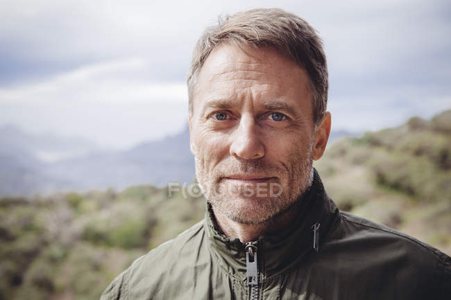 Portrait of mature man in the nature — Stock Photo