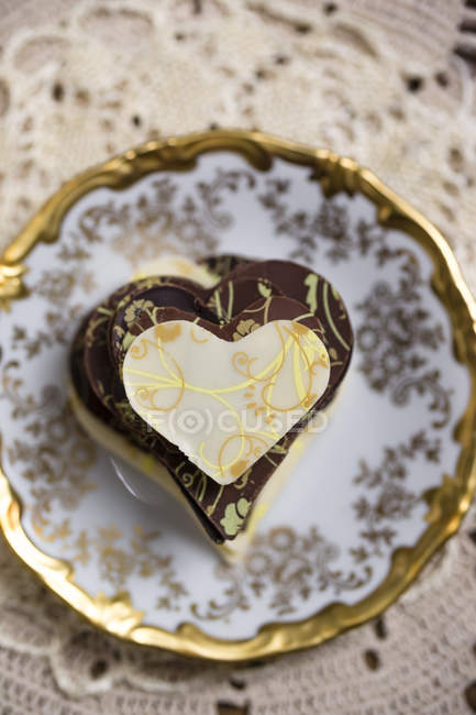 Stack of homemade chocolate hearts on plate — Stock Photo
