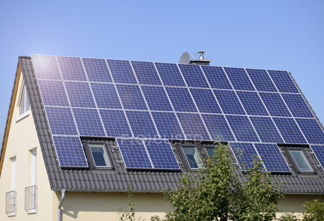 Germany, solar panels on roof top of one-family house — Stock Photo