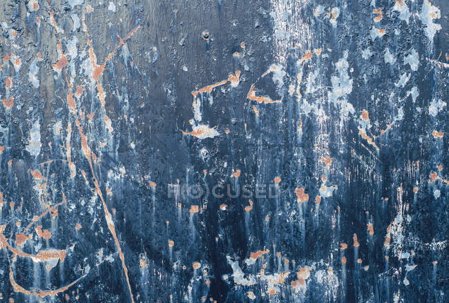 Abstract texture of blue painted damaged metal wall — Stock Photo
