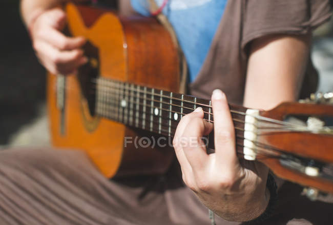 Close up of Woman playing guitar — Stock Photo