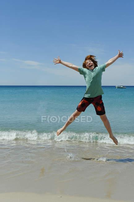 France, Corsica, Favone, boy having fun at a beach — Stock Photo