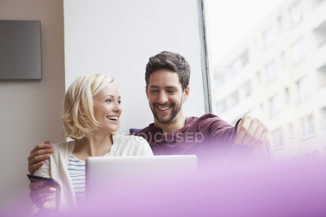 Happy couple using digital tablet for online shopping — Stock Photo