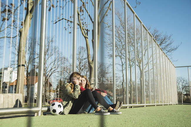 Teenage girls on sports ground — Stock Photo
