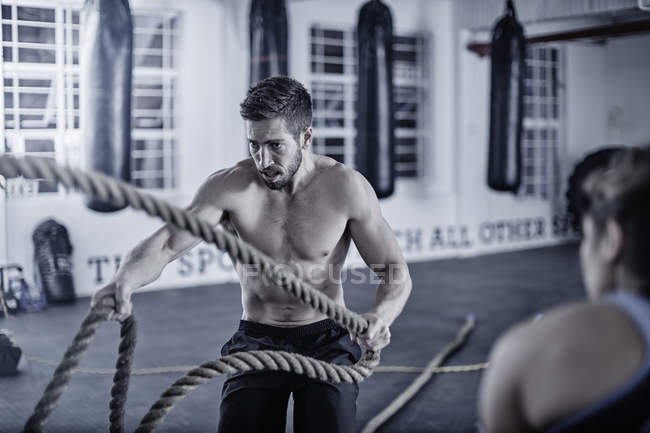 Man doing fitness training with ropes — Stock Photo