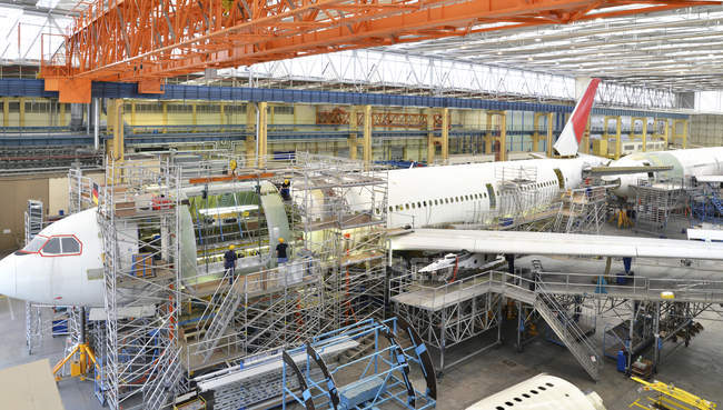 Airplane construction in a hangar indoors — Stock Photo