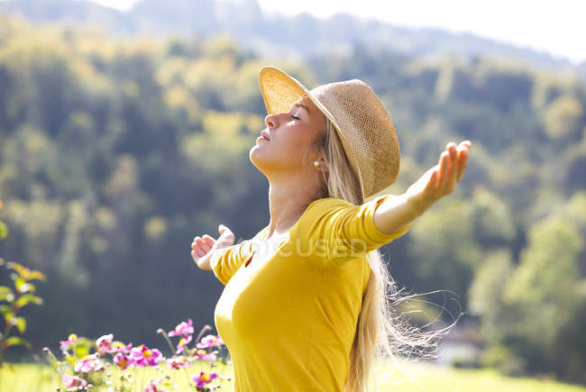 Relaxed teenage girl with outstretched arms — Stock Photo