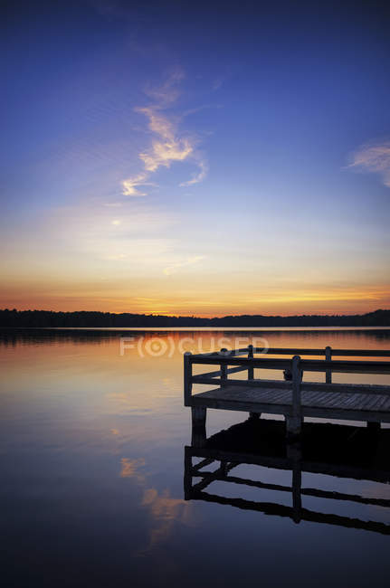 USA, Wisconsin, Rhinelander, sunset over water — Stock Photo