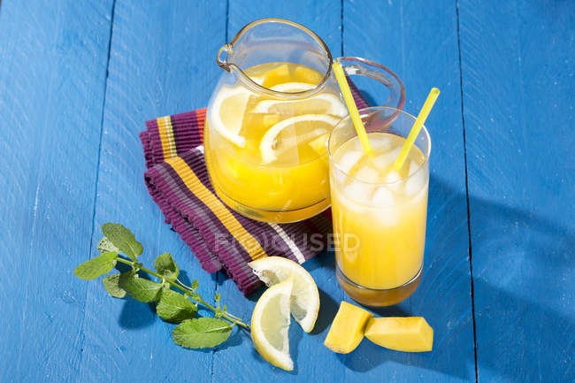 Cooled soft drink made of mango, lemon and mint — Stock Photo