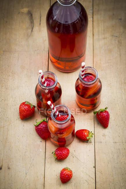 Glass bottles of homemade strawberry lemonade — Stock Photo