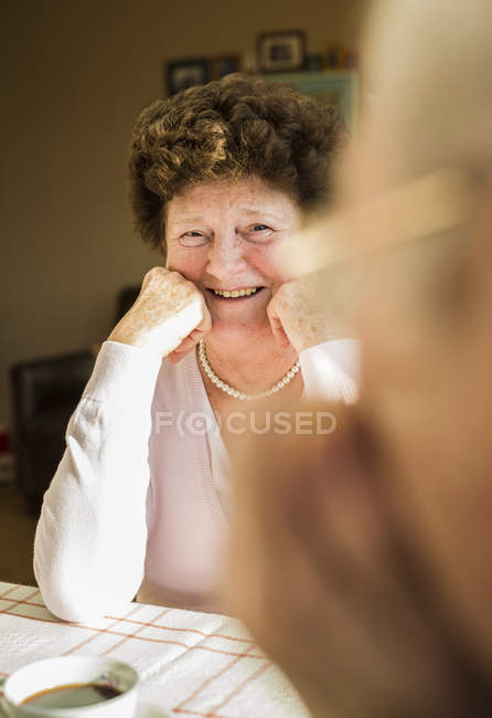Portrait of senior woman looking at her husband — Stock Photo