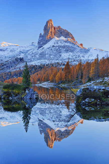 Italy, Dolomites, Belluno, mountain Becco di Mezzodi reflecting in Federa Lake at sunset — Stock Photo