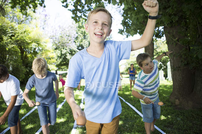 Portrait of boy winning in an egg-and-spoon race — Stock Photo
