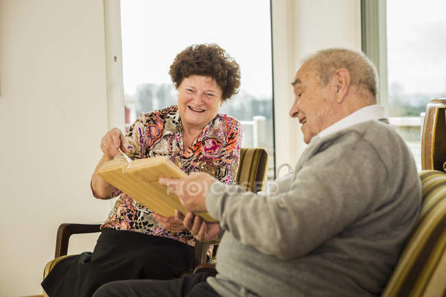 Senior couple watching photo album — Stock Photo