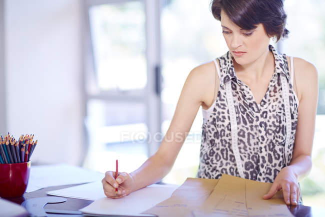 Fashion designer drawing on paper — Stock Photo