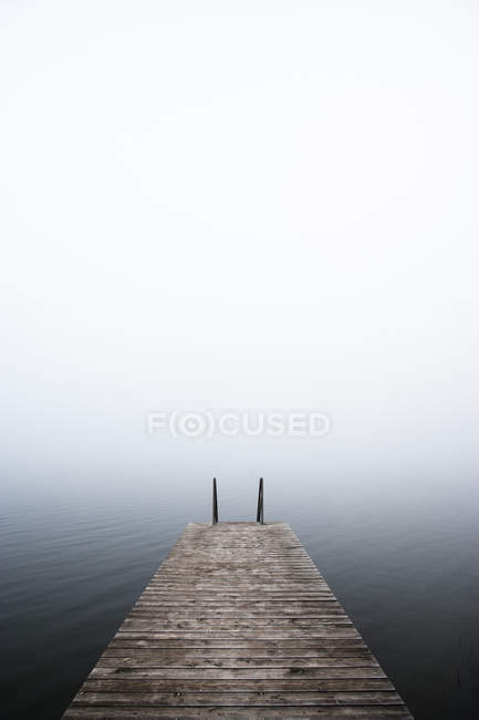 Bathing jetty in morning mist — Stock Photo