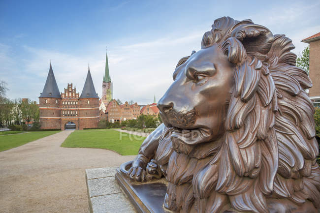 Germany, Luebeck, bronze Lion in front of Holsten Gate — Stock Photo