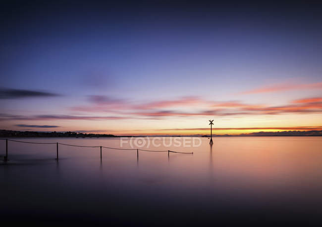 UK, Scotland, East Lothian, North Berwick, sunset over water — Stock Photo