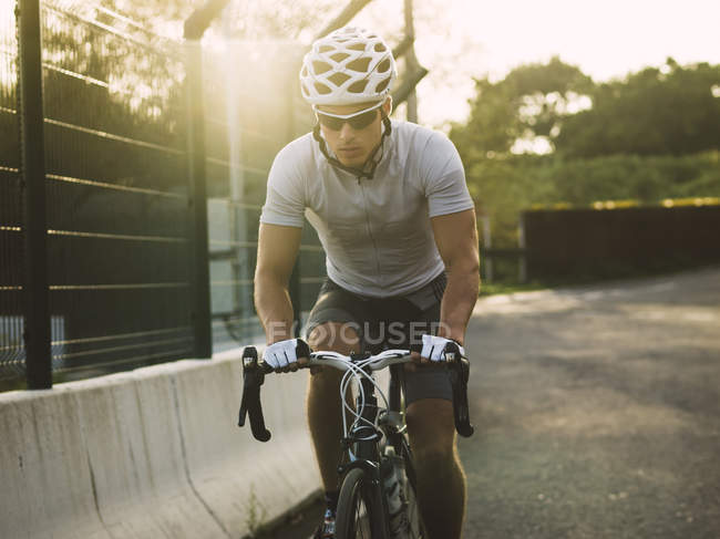 Racing biker wearing sunglasses and safety helmet — Stock Photo